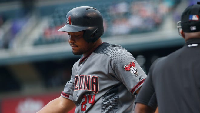 Arizona Diamondbacks' Yasmany Tomas reacts after striking out against Colorado Rockies starting pitcher Jorge De La Rosa in the first inning of a baseball game Saturday, June 25, 2016, in Denver.