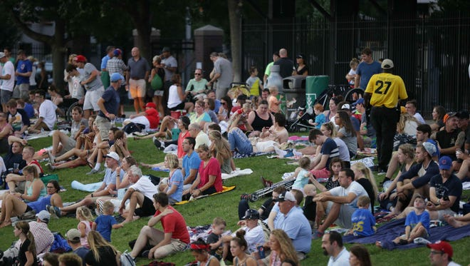 Fans watch the 20th anniversary of the Victory Field celebration game from the grass, as  the Indianapolis Indians VS the Toledo Mud Hens, Friday July 8th, 2016.