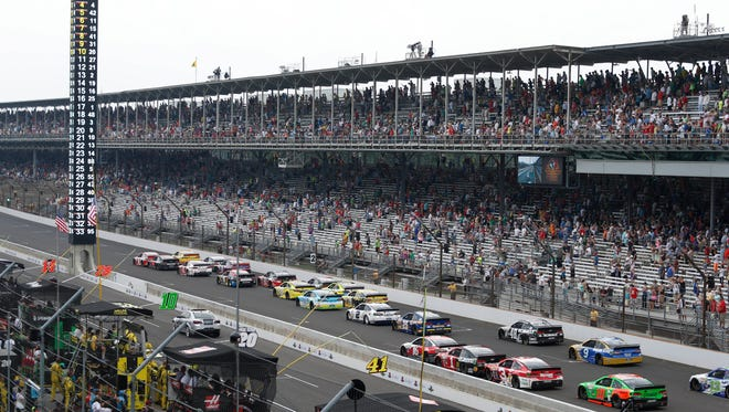The field takes off on a restart near the end of the 2015 Crown Royal 400 at Indianapolis Motor Speedway.