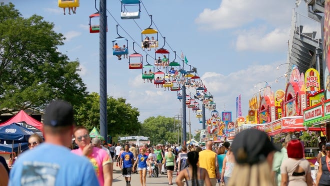 The Sky Glider overs above fair goers during the opening day of the Wisconsin State Fair at State Fair Park in West Allis on August 4, 2016.