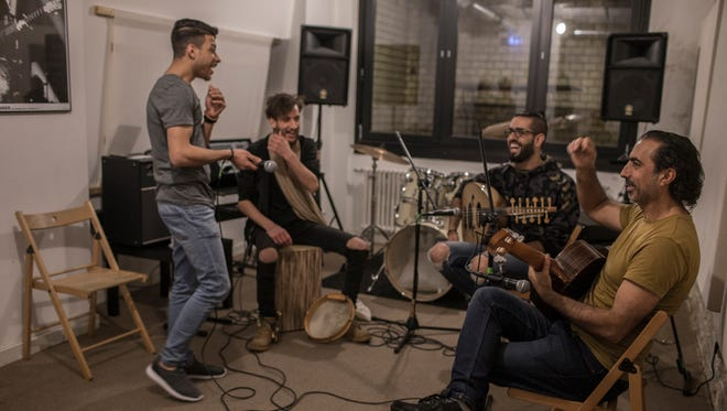 Musiqana band members Abdallah Rahal, Ali Hasan, Alaa Zaitouna and Adel Sabawi make jokes during a band practice at the Super Sessions cafe in Berlin. The Syrian band has been enchanting German audiences with traditional Arabic music.