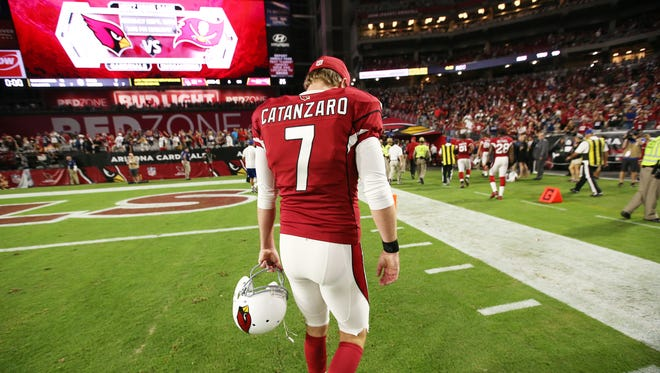 Arizona Cardinals' Chandler Catanzaro walks-off the field, head hanging low after missing a game-winning field goal late in the 4th quarter against the New England Patriots on Sep. 11, 2016 in Glendale, AZ.