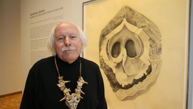Gendron Jensen's series of large pencil drawings of bones, nuts and flowers can been seen at the Haggerty Museum on the Marquette University campus. The bone necklace he is wearing include the sacrum of a deer (lower) and the vertebrae of a female wolf.