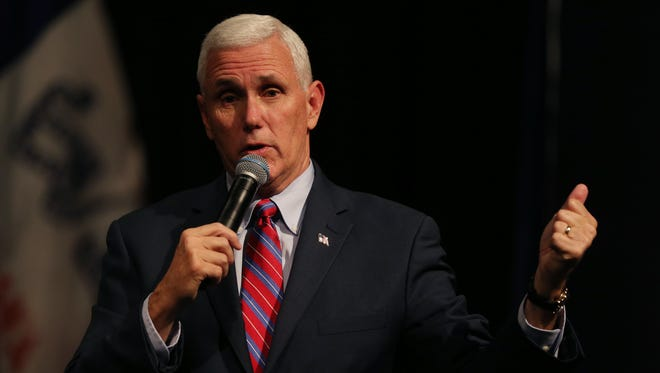 Mike Pence, the Republican vice presidential nominee, speaks to a crowd in an auditorium at the Des Moines Area Community College's Newton campus, on Tuesday, Oct. 11, 2016.