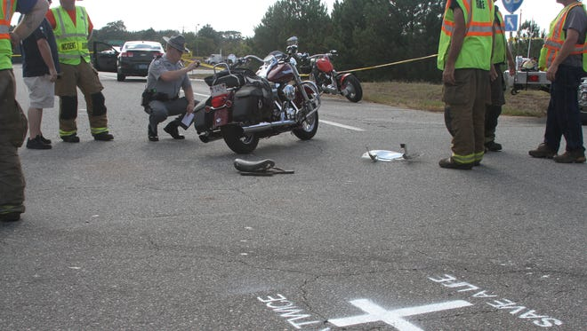 A South Carolina state trooper photographs the motorcycle involved in a fatal wreck with a car on S.C. 24 near Interstate 85 on Oct. 16.