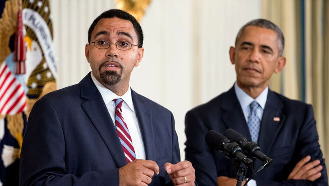 In this Oct. 2, 2015 file photo, Education Secretary nominee John King Jr., accompanied by President Obama, spoke in the State Dining Room of the White House.