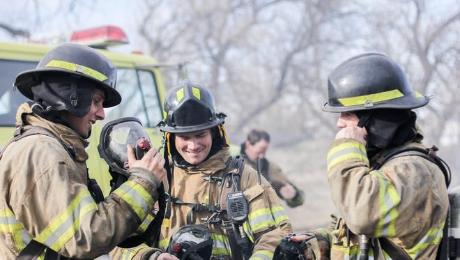 Adam Jordan, left, and Josh Fox, center, chat with another trainee during Great Falls Fire/Rescue's training academy in February.