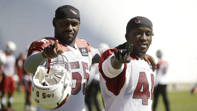 Arizona Cardinals linebackers Chandler Jones and Markus Golden on Tuesday, Oct. 19, 2016 at the Arizona Cardinals Training Facility in Tempe, Ariz.