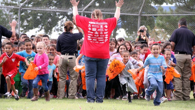 """Children in the 5-7 age group were turned loose at the second annual great Pumpkin Candy Drop held Saturday at John T. Waits """"Rabbit"""" Park in Deming's north side."""