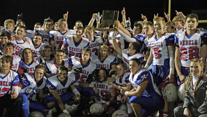 The Roncalli Rebels celebrate their sectional win over Greenwood Community High School at Greenwood, Friday November 4th, 2016.