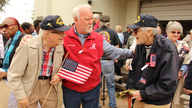 Ronnie Sherrer, center, introduces his father, Tom Sherrer, to Ed Ember at Friday's Veterans Day program in Selma. Tom Sherrer and Ember are World War II veterans.