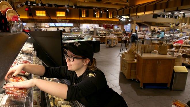 File photo: Donni Jones, stocks fresh deserts from the bakery at the Perinton, Wegmans.