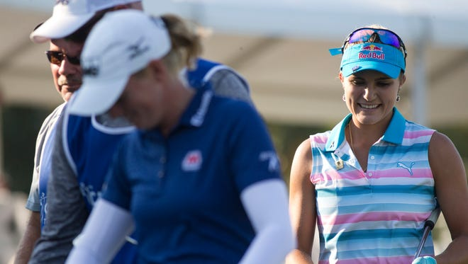Lexi Thompson smiles as she walks off the eighteenth hole during the CME Group Tour Championship at Tiburon Golf Club Thursday, Nov. 17, 2016 in Naples. Thompson finished the first round tied for nineteenth place with a score of one-under par.
