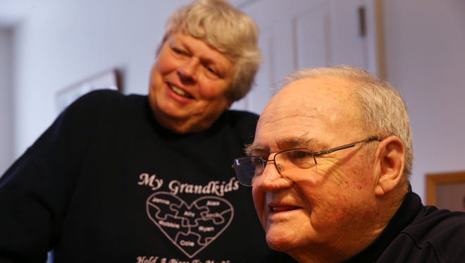 Werner Kleemann and his wife, Cheryl, watch their grandson Cole Kleemann play at their home. Werner is a Section V Hall of Fame football coach battling a rare form of leukemia that requires blood transfusions. His former players and the Rush-Henrietta school community organized blood drives in his honor.