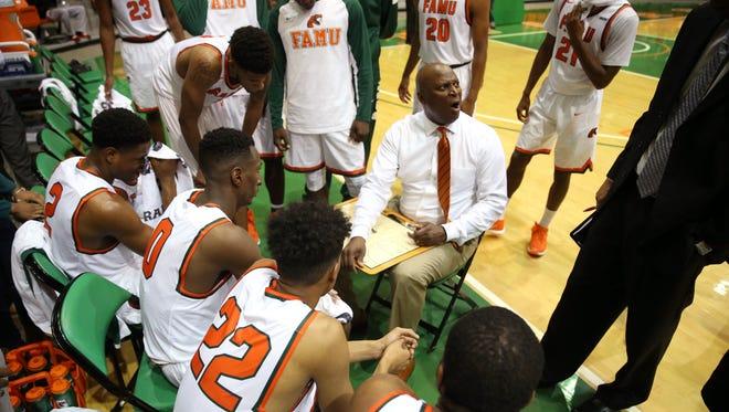 FAMU Head Coach Byron Samuels talks to his team during their game against Kennesaw State at the Al Lawson Center on Wednesday, Nov. 30, 2016.