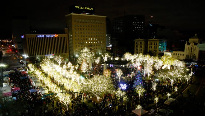 With the flip of a switch by El Paso Mayor Oscar Leeser, the Christmas lights lit up San Jacinto Plaza to the delight of thousands of people in attendance, during the Celebration of Lights event Saturday night.