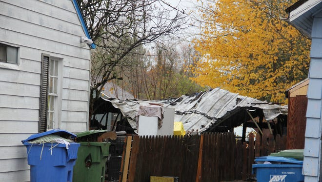 A fire spread through the backyard of a north Salem home early Monday morning, officials said.
