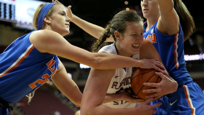 Florida State's Chatrice White battles Florida's Brooke Copeland and Haley Lorenzen for the ball during the first half.