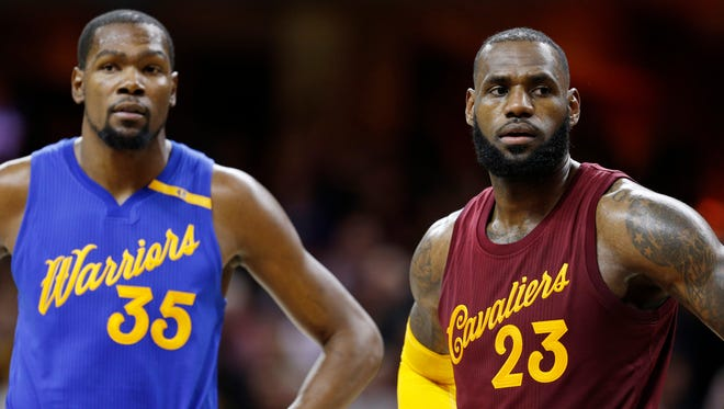 Golden State Warriors forward Kevin Durant (35) and Cleveland Cavaliers forward LeBron James (23) at Quicken Loans Arena.