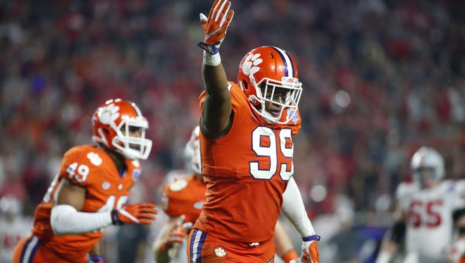 Clemson Tigers defensive end Clelin Ferrell (99) celebrates after sacking Ohio State Buckeyes quarterback J.T. Barrett (16) during the fourth quarter of the College Football Playoff Semifinal game in the PlayStation Fiesta Bowl on Dec. 31, 2016 at University of Phoenix Stadium in Glendale, Arizona.