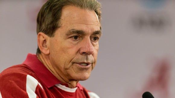 Alabama football coach Nick Saban talks with the media