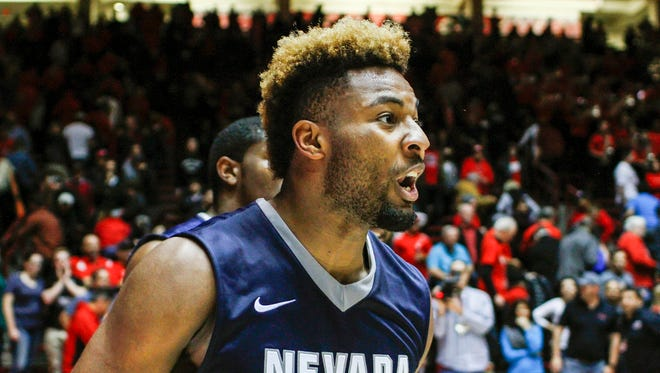Nevada's Jordan Caroline celebrates his team's miraculous win over New Mexico.