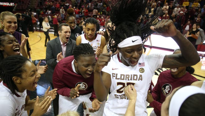 FSU's Shakayla Thomas celebrates with her teammates after their 72-65 win against Louisville at the Tucker Civic Center on Thursday, Jan. 12, 2017.