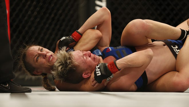 Nina Ansaroff (left) performs a rear choke-hold on Jocelyn Jones-Lybarger as she taps out at UFC Fight Night on January 15, 2017 in Phoenix, Ariz.