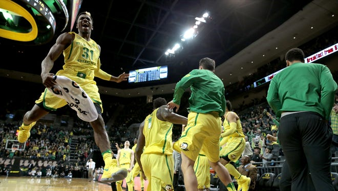 Jan 14, 2017; Eugene, OR, USA; Oregon Ducks guard Dylan Ennis (31) and forward Jordan Bell (1) celebrate a three point basket shot Ducks guard Charlie Noebel (10) along with the Oregon Ducks bench late in the second half against the Oregon State Beavers at Matthew Knight Arena. Mandatory Credit: Scott Olmos-USA TODAY Sports