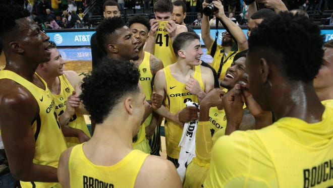 Feb 4, 2017; Eugene, OR, USA; The Oregon Ducks celebrate at the end of the game against the Arizona Wildcats at Matthew Knight Arena. Mandatory Credit: Scott Olmos-USA TODAY Sports