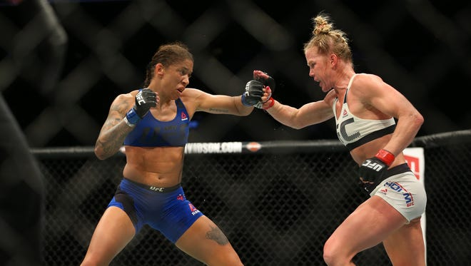 Feb 11, 2017; Brooklyn, NY, USA; Holly Holm (red gloves fights Germaine de Randamie (blue gloves) during UFC 208 at Barclays Center.