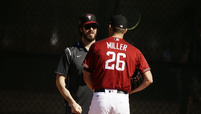 Arizona Diamondbacks pitcher Shelby Miller talks to former D-Backs pitcher Dan Haren during spring training camp on Feb. 16, 2017 at Salt River Fields in Scottsdale, Ariz.