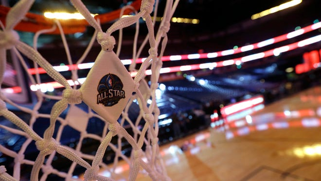 An NBA All-Star logo is affixed to the net as workers prepare the Smoothie King Center for the NBA All-Star events, which run through the end of the week in New Orleans, Thursday, Feb. 13, 2014.