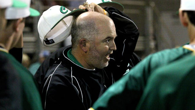 Catholic Coach Sonny Reedy scratches his head and urges his players to slow the game down after Pace took a 3-1 lead in the second inning.