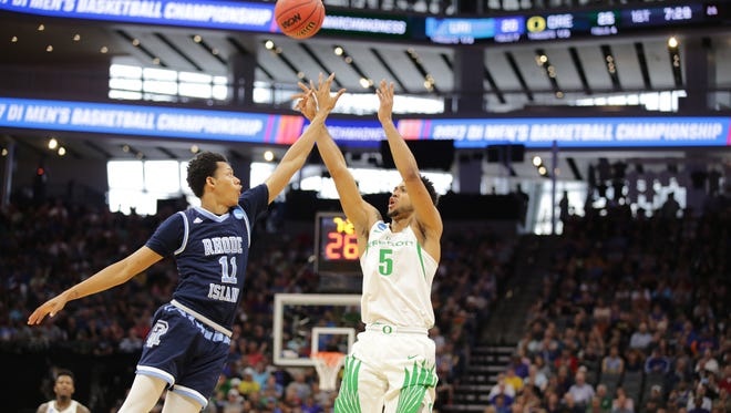 Mar 18, 2017; Sacramento, CA, USA; Oregon Ducks guard Tyler Dorsey (5) shoots the ball over Rhode Island Rams guard Jeff Dowtin (11) during the second round of the 2017 NCAA Tournament at Golden 1 Center. Mandatory Credit: Kelley L Cox-USA TODAY Sports