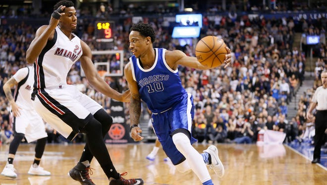 Toronto Raptors guard DeMar DeRozan (10) dribbles the ball past Miami Heat center Hassan Whiteside (21) at the Air Canada Centre. The Raptors won 96-94.