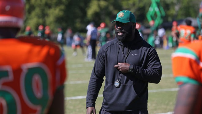 FAMU Offensive Line Coach Edwin Pata leads his team as they hold spring practice on the university's campus Saturday, April 8, 2017.