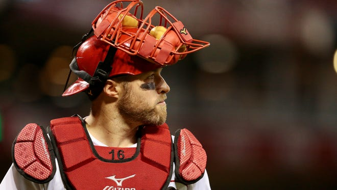 Cincinnati Reds catcher Tucker Barnhart (16) heads back to the dugout after the top of the ninth inning.
