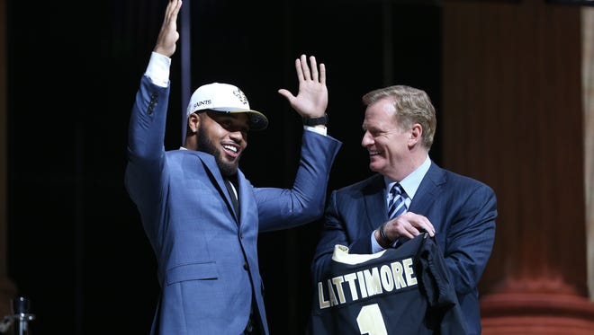 Apr 27, 2017; Philadelphia, PA, USA; Marshon Lattimore (Ohio State) reacts with NFL commissioner Roger Goodell (right) as he is selected as the number 11 overall pick to the New Orleans Saints in the first round the 2017 NFL Draft at the Philadelphia Museum of Art. Mandatory Credit: Bill Streicher-USA TODAY Sports