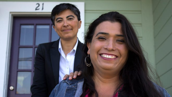 Lisa Cisneros, LGBT program director for California Rural Legal Assistance, with Roselyn Macias, an agriculture worker and community leader with a Latino-led LGBT group called Conexiones of Monterey County.