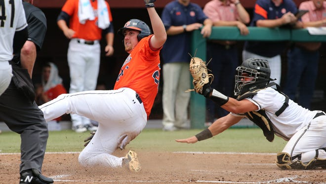 Auburn's Daniel Robert slides into home during Auburn's 7-4 victory over UCF.