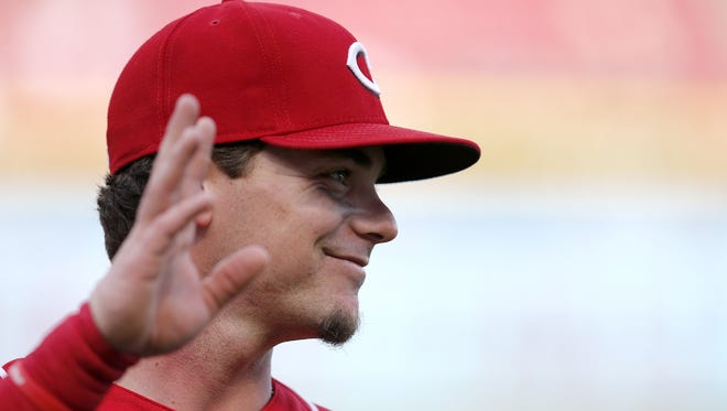 Cincinnati Reds second baseman Scooter Gennett (4) waves as he's introduced during a ceremony before the game between the Cincinnati Reds and the Los Angeles Dodgers at Great American Ball Park on Friday, June 16, 2017.