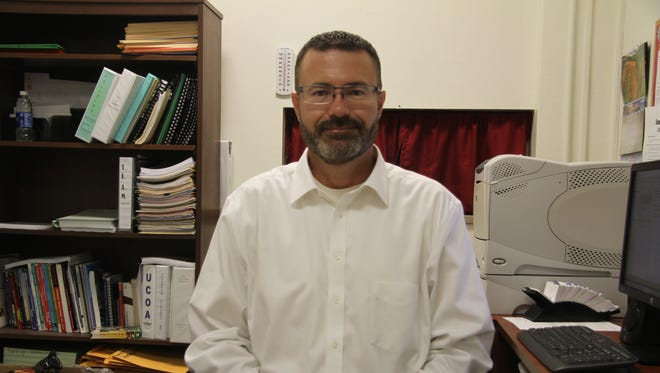 Justin Gossett has been named special education director for Carlsbad Municipal Schools. Gossett will succeed director Shirley Jones, who plans to retire. Gossett sits at his new desk at the special education office in Edison school building on June 20, 2017.