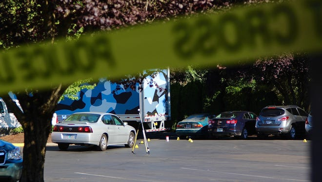 Salem Police detectives investigate a fatal shooting in the Best Western Plus Mill Creek Inn parking lot on Saturday, July 22, 2017.