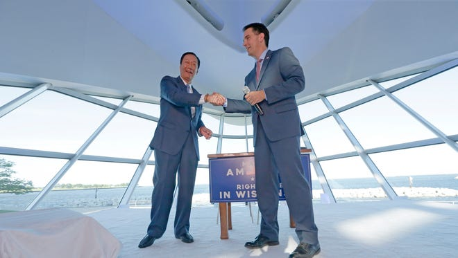 Foxconn Chairman Terry Gou and Gov. Scott Walker shake hands during the Foxconn announcement.
