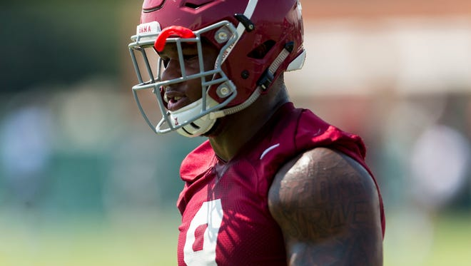 Alabama defensive lineman Da'Shawn Hand (9) works through drills during NCAA college football practice, Friday, Aug. 4, 2017, at the Thomas-Drew Practice Fields in Tuscaloosa, Ala.