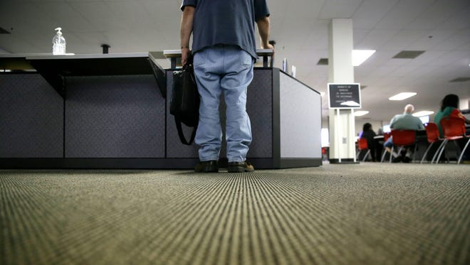 A job seeker checks in at the Texas Workforce Solutions Office in Dallas.