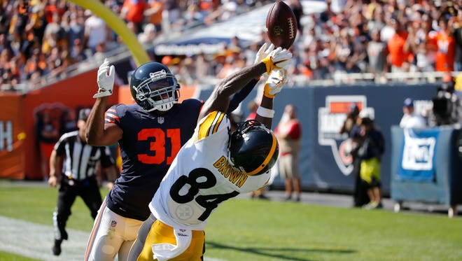Chicago Bears cornerback Marcus Cooper (31) breaks up a pass intended for Pittsburgh Steelers wide receiver Antonio Brown (84) during the second half of an NFL football game, Sunday, Sept. 24, 2017, in Chicago. (AP Photo/Charles Rex Arbogast)
