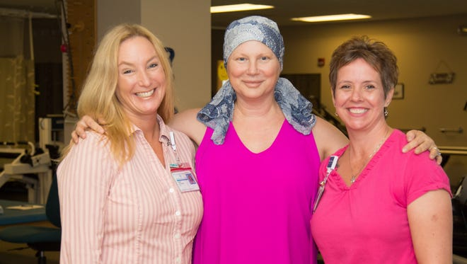 Diana Pratt (center), was grateful for the healing hands of two Martin Health therapists: Tara Anstensen (left), physical therapy assistant and Kristin Montgomery (right), occupational therapist.