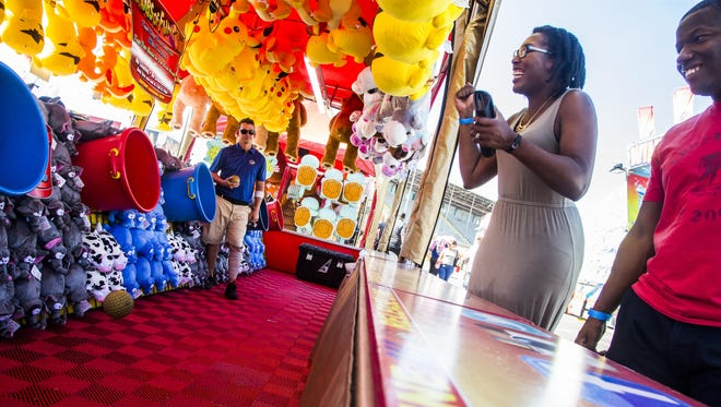 Kelly and Ronald Brooks react after just missing a prize at the Arizona State State Fairgrounds in Phoenix on Oct. 6, 2017.